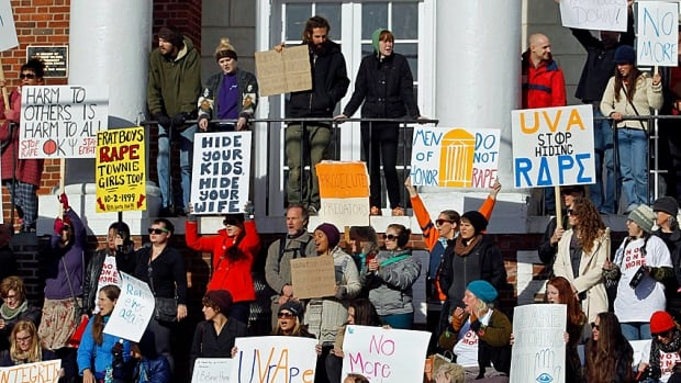 Demonstrators with signs gathered at the Phi Kappa Psi fraternity house at the University of Virginia in Charlottesville in November following the publication of the Rolling Stone article.