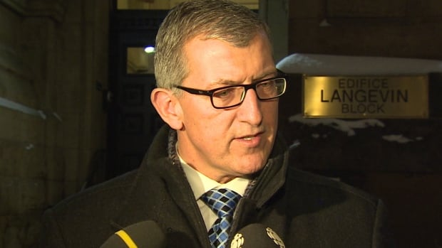 Newfoundland and Labrador Premier Paul Davis wants to know where NL politicians stand on the dispute between Ottawa and the province over a fisheries fund related to Canada's free trade agreement with the European Union.