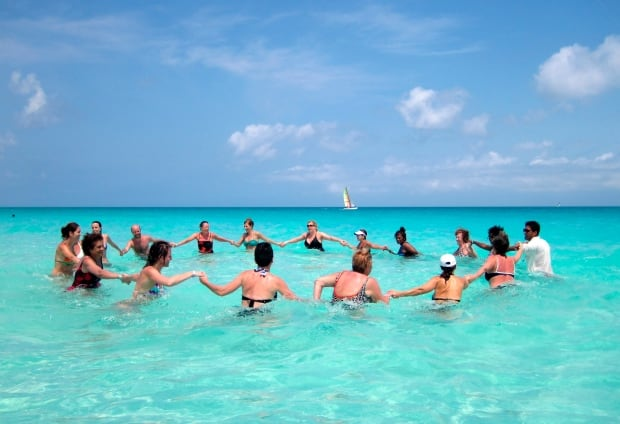 Tourists exercise in the water at a resort in central Cuba in 2013 ...