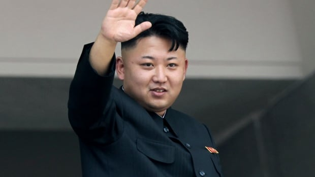 North Korea's leader Kim Jong Un waves to spectators and participants of a mass military parade celebrating the 60th anniversary of the Korean War armistice in Pyongyang.