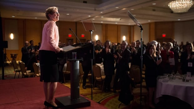 Ontario Premier Kathleen Wynne receives applause before delivering remarks during an Economic Club of Canada luncheon in Toronto on Dec. 15.