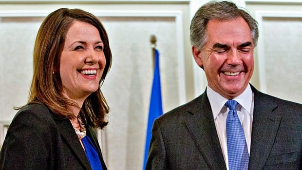 Alberta Premier Jim Prentice and former Wildrose leader Danielle Smith speak to the media following a PC caucus meeting in Edmonton Wednesday, and after Smith and eight other Wildrose MLAs crossed the floor.
