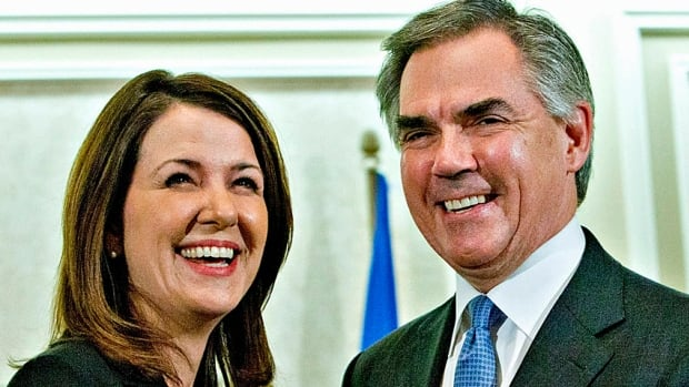 Alberta Premier Jim Prentice and former Wildrose leader Danielle Smith speak to the media after a caucus meeting in Edmonton, on Dec. 17, 2014.