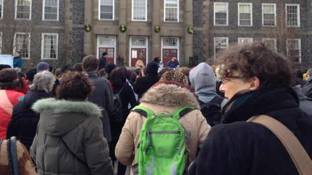 At least 200 people marched to Dalhousie President Richard Florizone's office Friday.