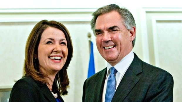 Alberta Premier Jim Prentice and former Wildrose leader Danielle Smith speak to media after a caucus meeting in Edmonton on Wednesday. Prentice's caucus met to discuss a bid by at least half the Official Opposition to cross the floor.
