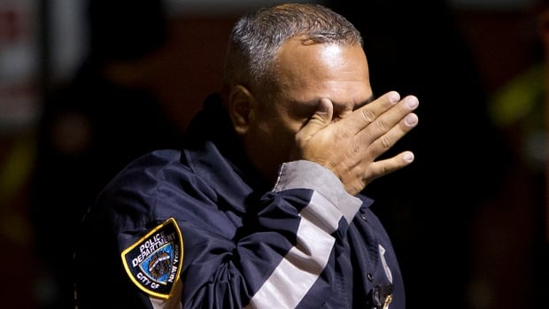 A gunman fatally shot two New York police officers as they sat in their squad car on Saturday and then killed himself, in what may have been a revenge attack over police treatment of minorities, U.S. media said.