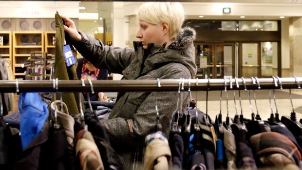 A woman shops at Nordstrom store in Chicago. The luxury retailer has opened in Calgary and plans more stores across Canada.