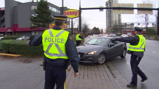This driver is about to get a ticket from police for distracted driving.