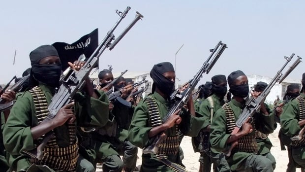 Hundreds of newly trained al-Shabaab fighters march south of Mogadishu in 2011. A Somali intelligence official says Zakariya Ismail Ahmed Hersi, a leader with the Islamic extremist group al-Shabaab, has surrendered to police in Somalia.