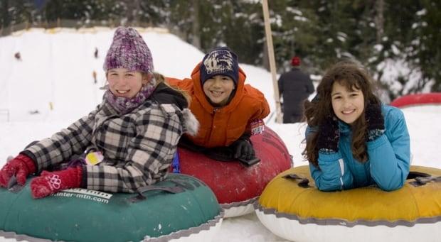 Kids tubing at Mount Seymour