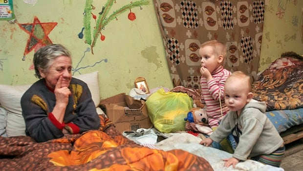 A Ukrainian family in Donetsk camps out in their basement, which they are using as a bomb shelter and which they have tried to adorn with festive decorations.