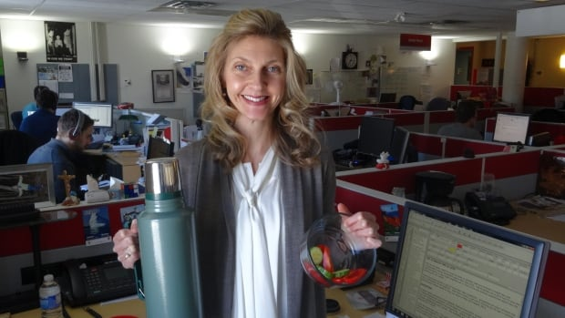 CBC journalist Jane Adey has assembled 15 tips for healthy living in 2015. She is seen here holding a Thermos of water and a tray of vegetables, two very important ingredients in a healthy diet.