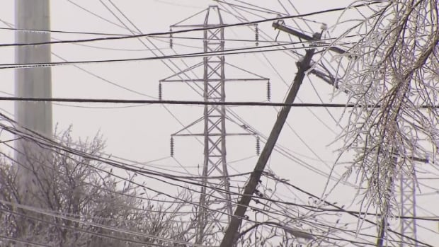 A Hydro-Québec pole teeters as freezing rain casts the province in ice. Thousands of hydro customers are without power in Quebec on Sunday, as the first blast of winter in 2015 wreaks havoc in the province and across the country.