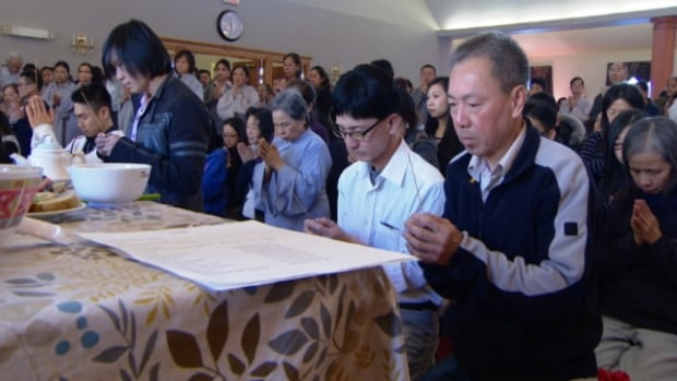 Hundreds of people knelt to offer prayers and food in the memory of the people left dead after last week's shootings.