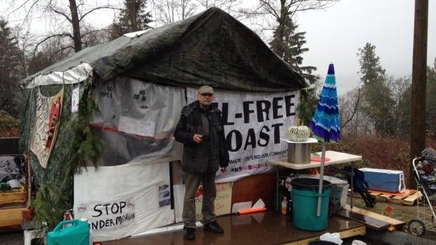 Mehran Mrani-Ghrajulou stands at the camp protesters set up outside  Kinder Morgan's TransMountain Westridge Marine Terminal.