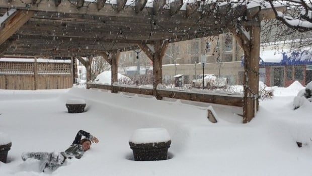 """A staff member at The Noble Pig in Kamloops goes for a """"swim"""" on the patio."""