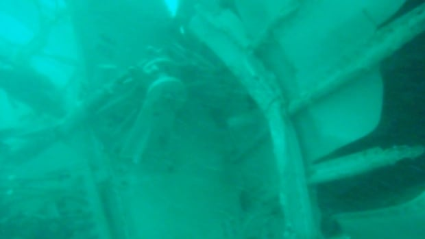 In this undated underwater photo released by Indonesia's National Search And Rescue Agency (BASARNAS) on Wednesday, the part of the wreckage of AirAsia Flight 8501 is seen.