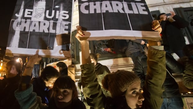 Protesters express solidarity with the satirical weekly Charlie Hebdo during a demonstration in Paris on Thursday.