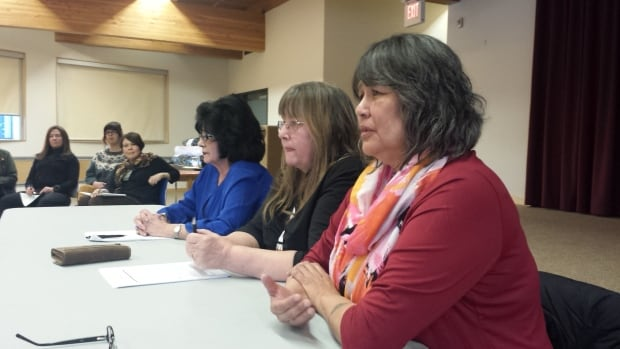Lynn Brooks, Arlene Hache and Sandra Lockhart at a teach-in organized just before the Walking With Our Sisters travelling exhibit opened in Yellowknife.