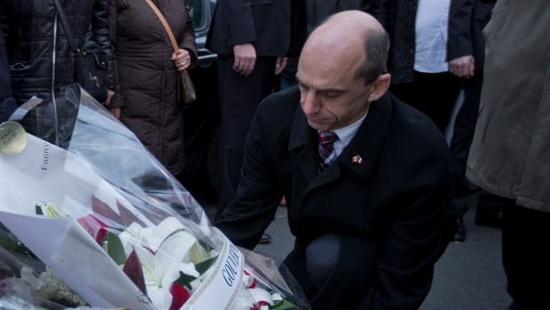 Steven Blaney, Canada's minister of public safety, lays a wreath after last week's attack on a kosher market in which four hostages died in Paris, France. Blaney issued a statement Sunday saying security agencies had measures in place to address any threats after a video threatening Canada surfaced.