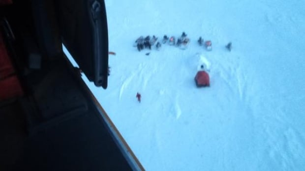 A Cormorant helicopter from Joint Task Force Atlantic picked up a group of hunters stranded on an ice floe.