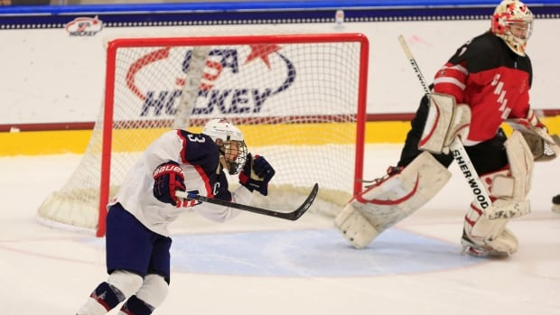 Jincy Dunne scored two goals, including the winner in overtime, as the United States edged Canada 3-2 in the women's IIHF U-18 championship in Buffalo, N.Y.