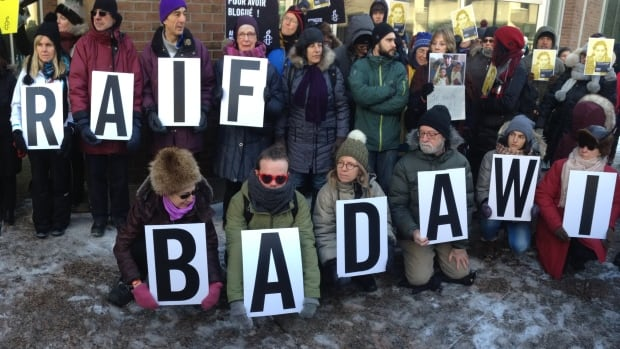 Protesters gather at a protest for Saudi blogger Raif Badawi in Montreal Tuesday. He was sentenced to up to 10 years in prison, 1,000 lashes and a fine for creating an online forum for public debate and insulting Islam.