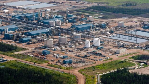 'The Suncor oil sands facility near Fort McMurray, Alta., one of the largest. Suncor announced this week that it was cutting spending by $1 billion in 2015 and laying off 1,000 employees.