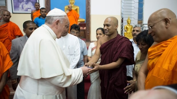 Pope Francis greets members of the Buddhist community as he visits the Agrashravaka Buddhist Temple in Colombo on Wednesday.
