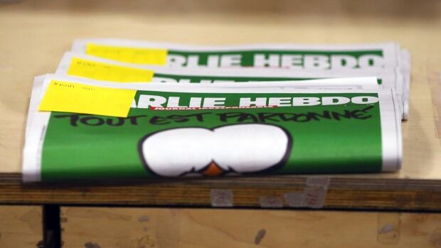 Reserved copies of the first edition of Charlie Hebdo published after the deadly attacks by Islamist gunmen in Paris last week appear in a bookstore in Brussels Thursday.