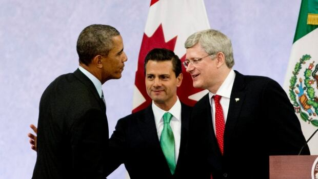 U.S. President Barack Obama, Mexican President Enrique Pena Nieto, centre, and Prime Minister Stephen Harper met in Toluca, Mexico, last February. Their next summit, hosted by Canada, appears to be postponed to later in 2015.