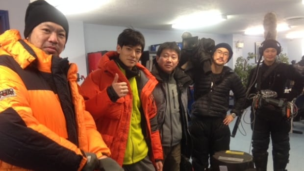 Producers from Japanese public broadcaster NHK and host Akumu Nakajima, second from left, pose for a photo before boarding a plane to Whati, N.W.T. They'll be in the small northern community for two weeks shooting a documentary.