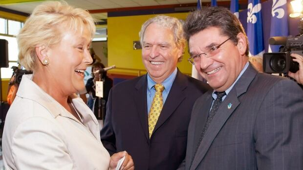 Former Bloc Quebecois MP Michel Guimond, right, shakes hands with former Parti Quebecois Leader Pauline Marois, left, in 2007 as then-PQ MLA Rosaire Bertrand looks on. Guimond has died of heart failure at the age of 61.