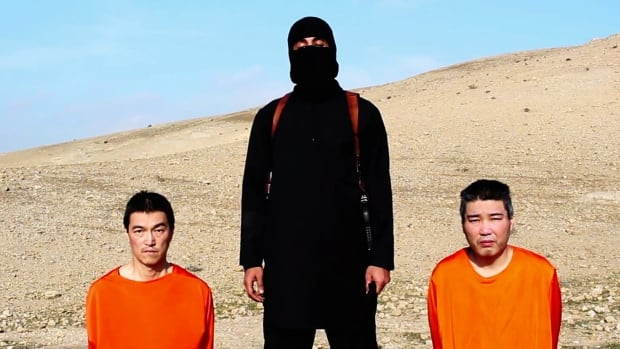 In a video released Tuesday, a black-clad figure wielding a knife gave Japan 72 hours to pay $200 million US to release two Japanese nationals being held by ISIS.