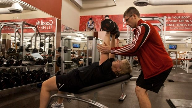 A trainer helps a client at the GoodLife Fitness club in Dartmouth, N.S. GoodLife says it's considering expanding to former Target locations.
