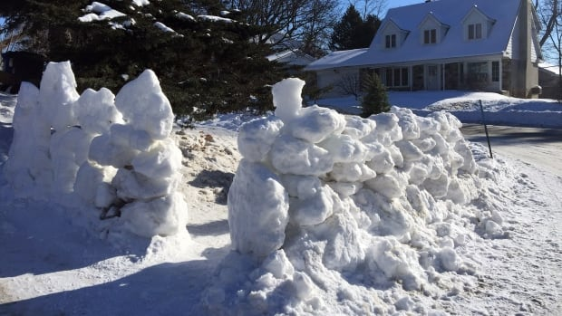 Yann Lefebvre said he intentionally built an open-air snow fort so that he could keep an eye on the kids while they were playing in the fort.
