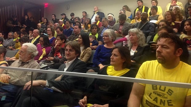 Bus lane advocates wore yellow and crowded the gallery of Wednesday's meeting.