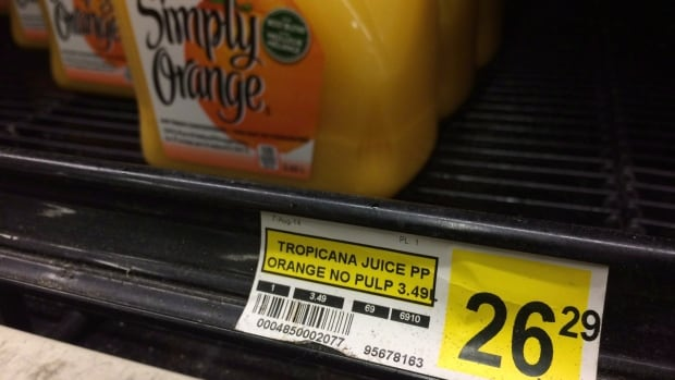 A price tag lists the price of a jug of orange juice at a grocery store in Iqaluit, Nunavut on December 8, 2014. The federal government annnounced in July that retailers would have to spell out on receipts how much consumers were saving due to the Nutrition North food subsidy, but a University of Toronto professor says that the change hasn't made the much-maligned subsidy more transparent or effective.