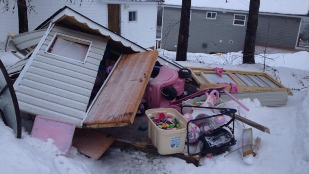 A child's playhouse was crushed in a backyard in Mount Moriah near Corner Brook.