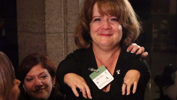 An emotional Mercedes Benegbi, executive director of the Thalidomide Victims Association of Canada, shows her relief after the House of Commons voted to compensate survivors of thalidomide back in December.