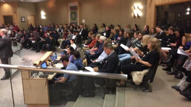 A packed city council chamber Monday.