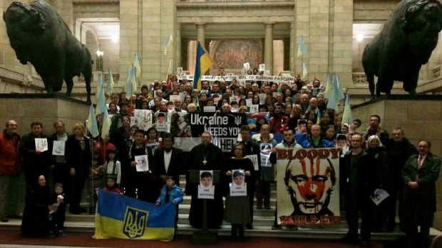 Dozens from the local Ukrainian community gathered at the Manitoba Legislature Monday night at a rally to press the Russian government to release Nadiya Savchenko, an imprisoned Ukrainian army pilot captured by pro-Russian forces in Eastern Ukraine last year.