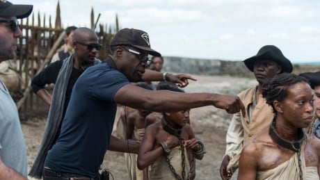 http://i.cbc.ca/1.2935162.1422472537!/fileImage/httpImage/image.jpg_gen/derivatives/16x9_460/clement-virgo-on-set-the-book-of-negroes.jpg