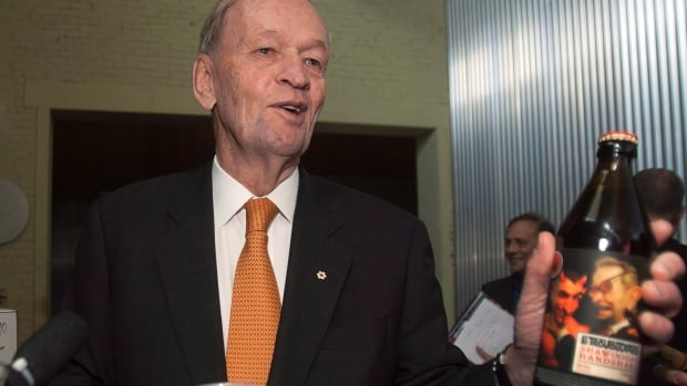 """Former prime minister Jean Chrétien tries a sample of a beer called the Shawinigan Handshake in 2012. Don't know what """"Shawinigan handshake"""" refers to? Well, now there's a dictionary for that."""
