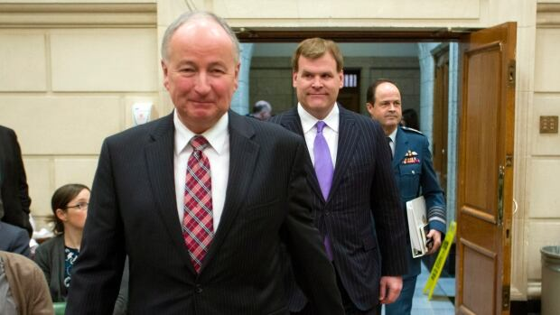 Defence Minister Rob Nicoholson is followed by Foreign Affairs Minister John Baird and Chief of Defence Staff Gen. Tom Lawson as they make their to appear at the House foreign affairs committee to discuss Canada's response to ISIS on Jan. 29, 2015.