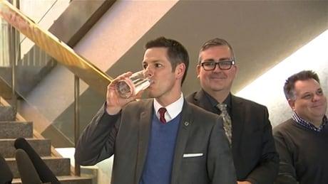 Mayor Brian Bowman drinks water