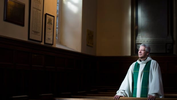 Reverend Yves Samson poses for a photograph following mass at St. James Anglican Church in Trois-Rivières, Que., Sunday, Jan. 25, 2015. Samson holds nothing back when he says that, without radical change, the Anglican Diocese of Quebec could soon be extinct.