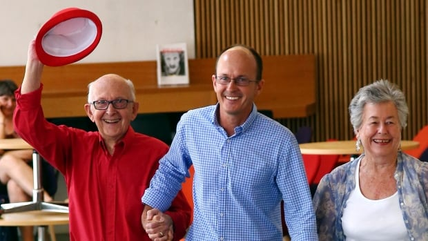 Juris, left, and Lois Greste, parents of Australian journalist Peter Greste, and his brother Andrew, centre, arrive at a news conference in Brisbane, Australia on Monday. Peter Greste, a reporter for Al-Jazeera English, was released from an Egyptian prison and deported Sunday after more than a year behind bars.