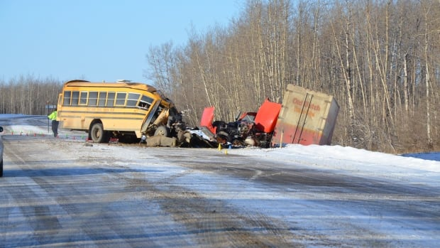 A bus driver was killed and 14 students were injured this morning when a school bus collided with a truck near Grimshaw, Alta.