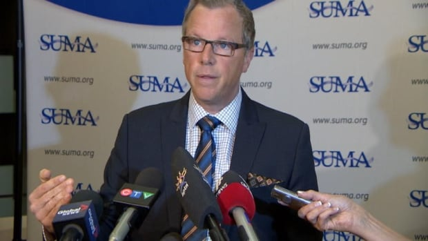 Saskatchewan Premier Brad Wall spoke to reporters following a speech given to delegates at a meeting of municipal leaders.